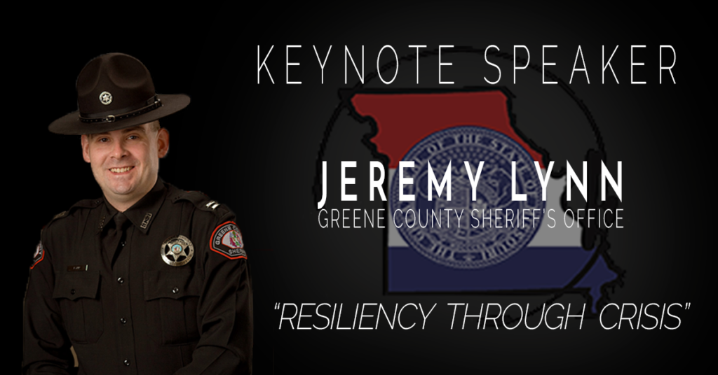 "Black image with a photo of Capt. Lynn in Department Uniform. To the right of Capt. Lynn is the announcement that he is the Keynote Speaker, along with his name below which is Greene County Sheriff's Office. Behind the name and office is a faded version of the MPSCC logo. Below this is the session title ""Resilience Through Crisis"""